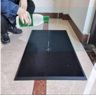 use sanitizing foot mat